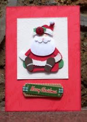 Kerstkaarten: De kerstbeer voor het raam
